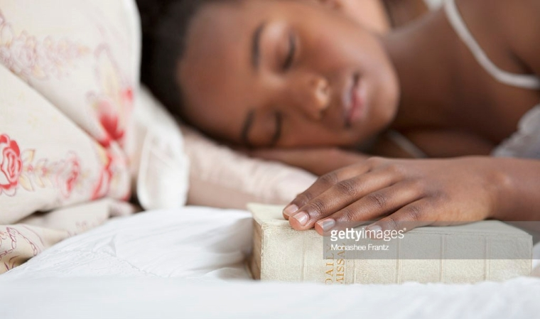 Girl sleep with bible