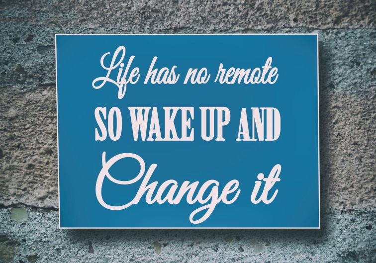 Life has no remote, so wake up and change it. Motivation, poster, quote, New Year quote, concrete background, blue paper